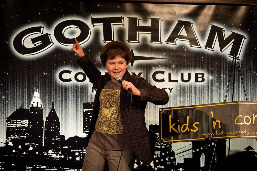 A kid performs for Kids 'N Comedy