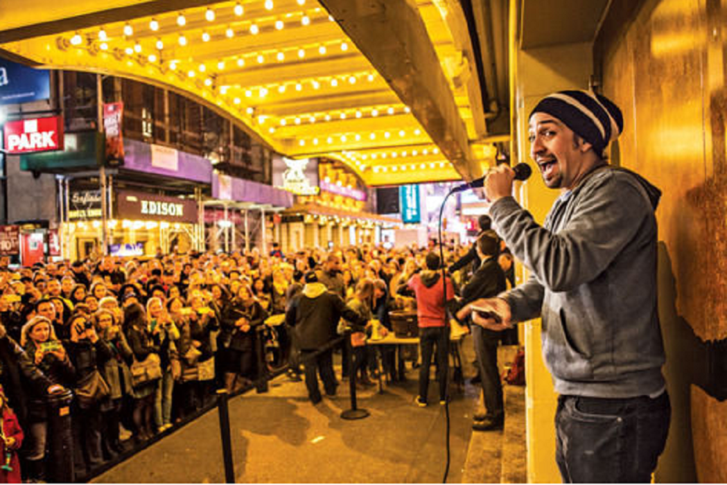 Lin-Manuel Miranda outside the Richard Rodgers Theatre with a crowd of lottery participants