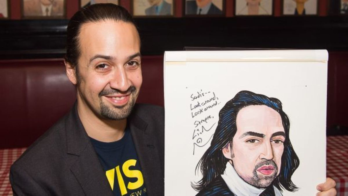 Lin-Manuel Miranda poses with his Sardi's caricature